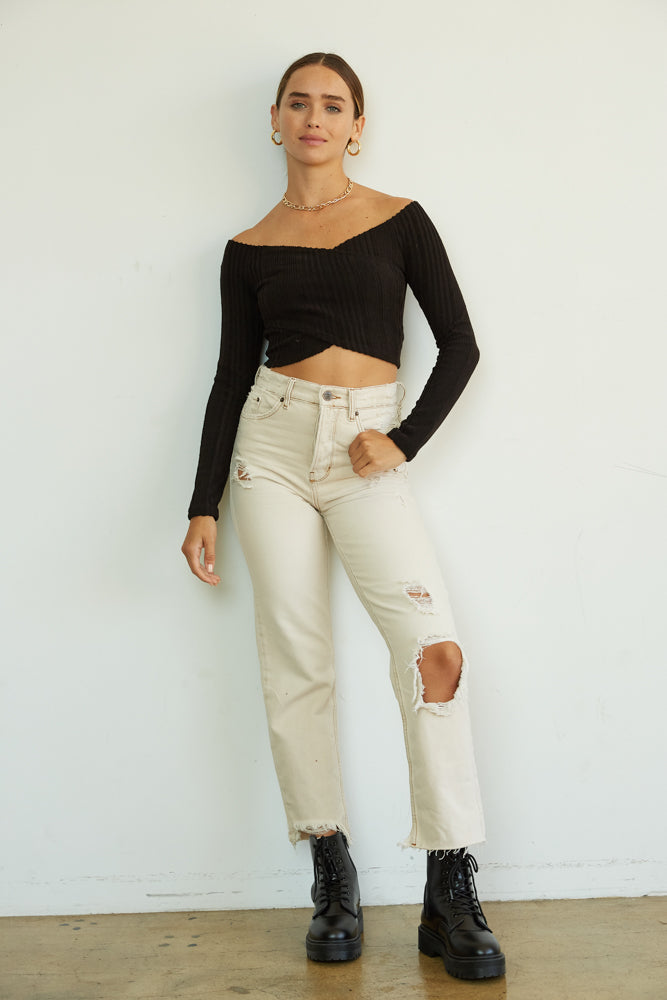 These high waisted jeans are complete with holes throughout.