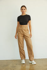 Cropped top with crew neckline and ruched body.