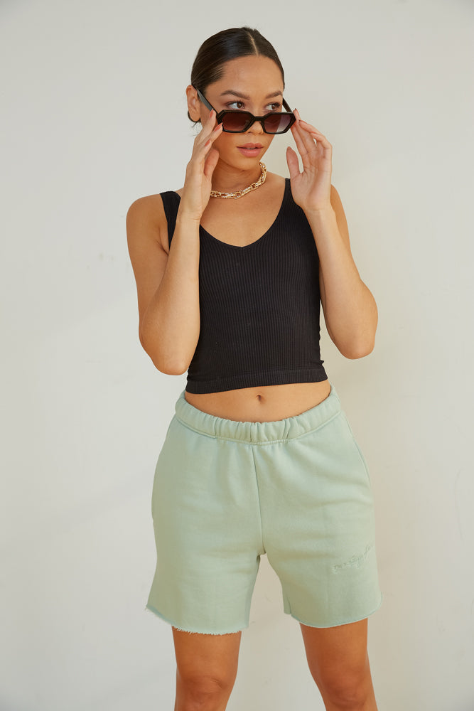 Sage green bermuda shorts.