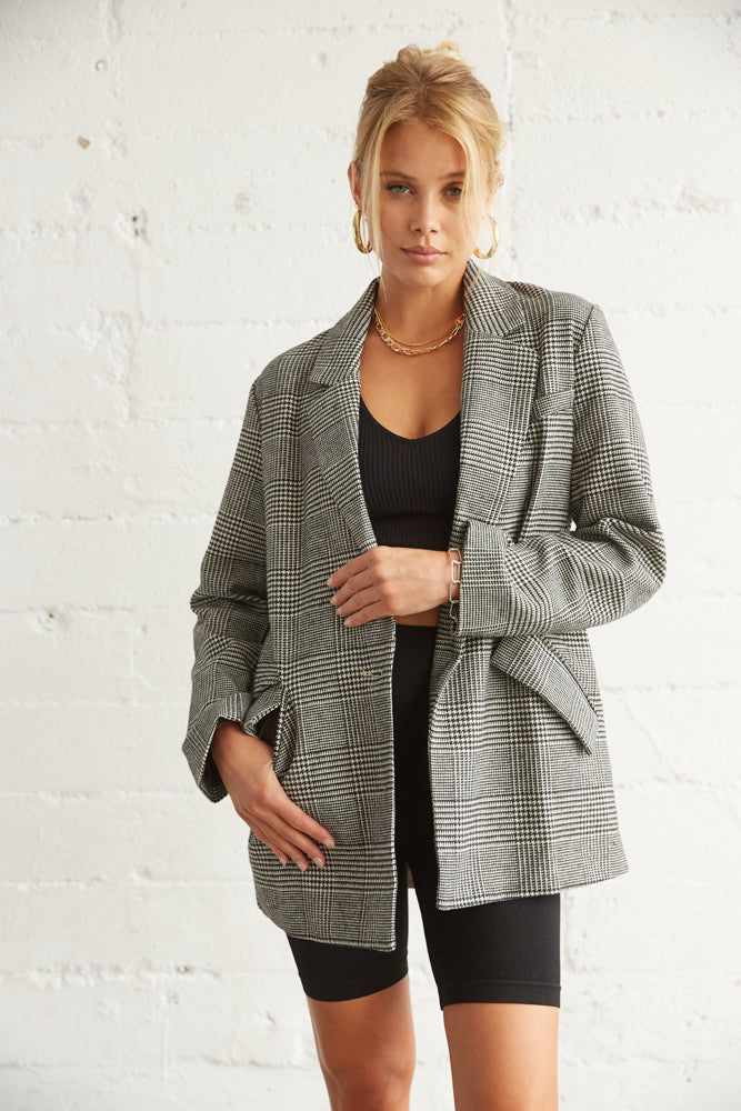 Structured blazer with open front and boxy silhouette.