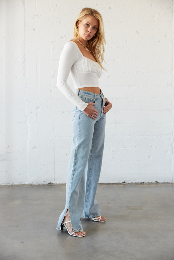 The side of these pants have a slit detail at the foot.