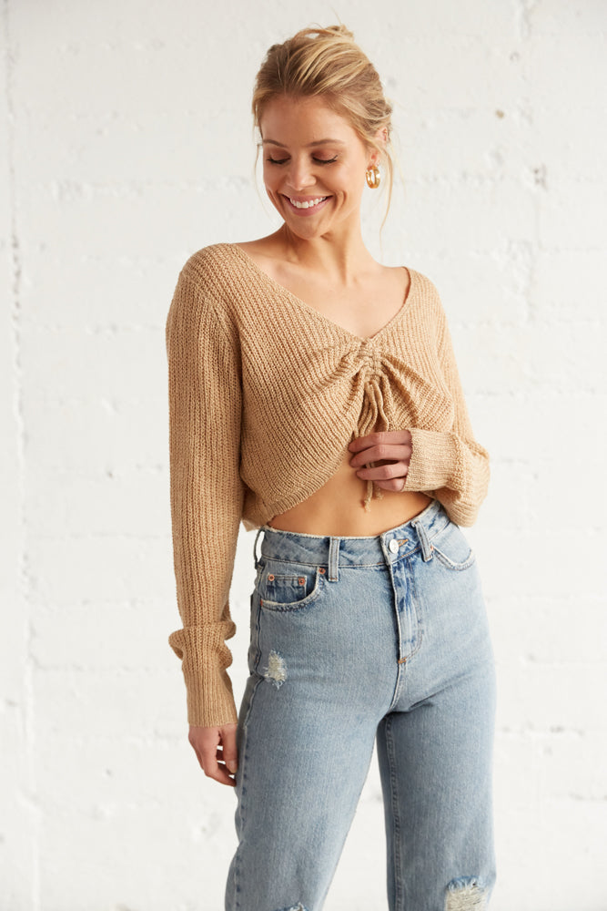 Cinched crop top with loose knit design.