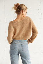 The back of this sweater is cropped and relaxed.