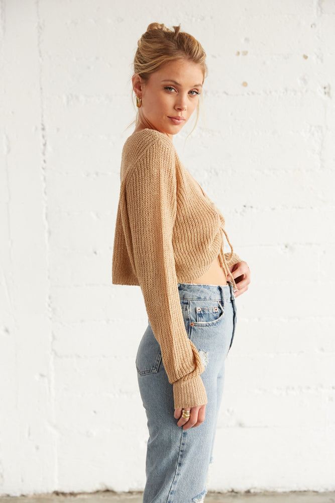 The side of this sweater top has long knit sleeves.