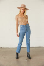 High rise jeans with subtle distressing.