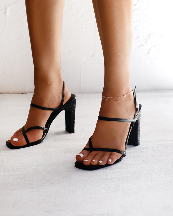 Black Billini strappy heels.