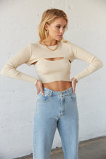 Beige cropped sweater set with long sleeves.