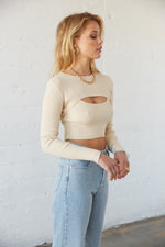 Long sleeve crop top with ribbed detailing.
