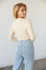 The back of this sweater is cropped and fitted.