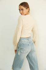 The back of these jeans are complete with pockets and distressed detailing.