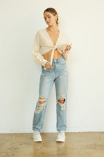 distressed high rise jeans.