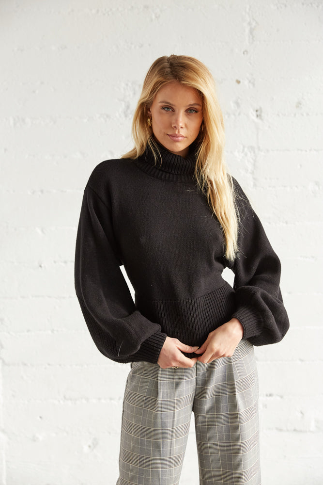 This sweater has a relaxed fit and long balloon sleeves.