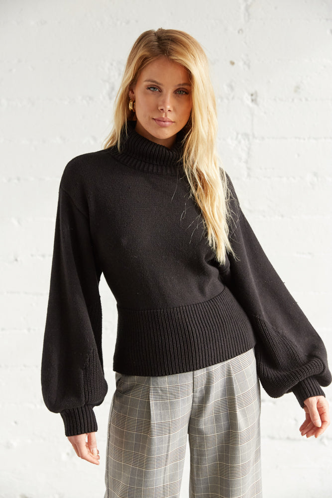 Slouchy long sleeve details and a ribbed hem.
