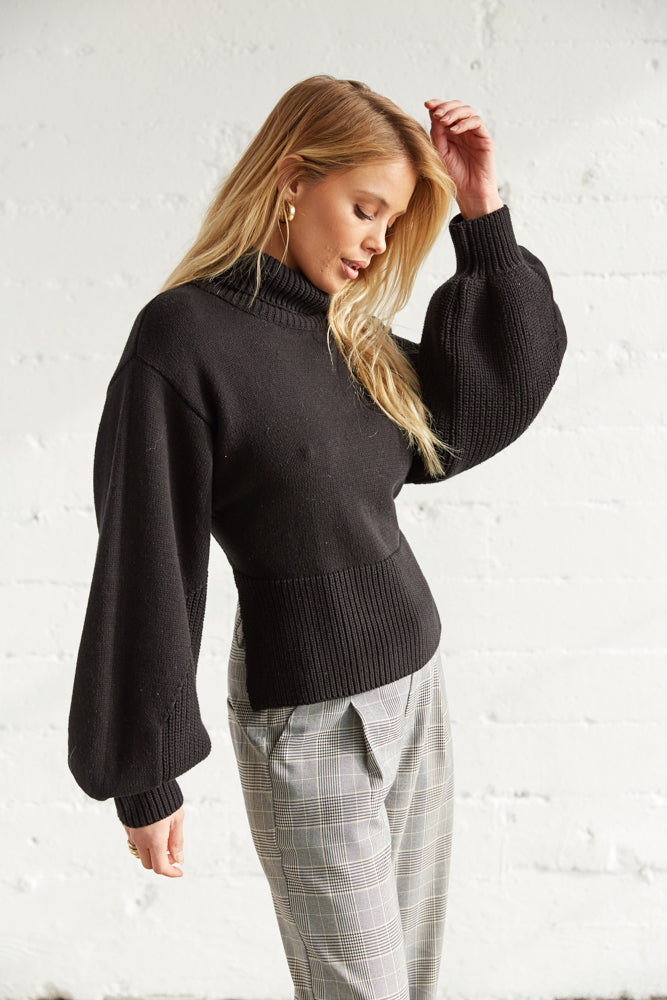 The side of this sweater shows off the long balloons sleeves.