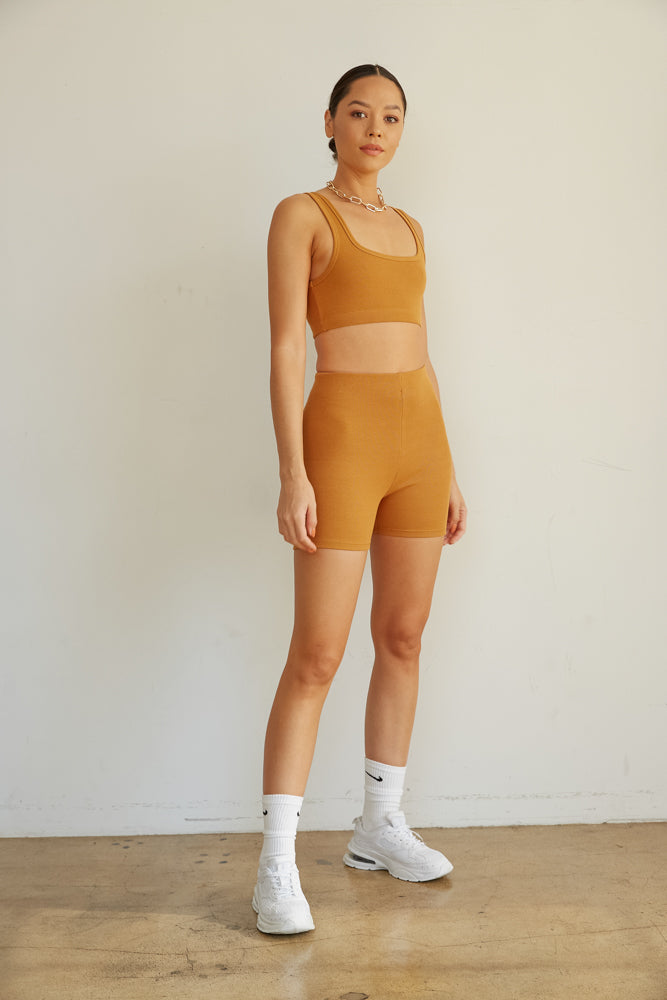 This adorable ribbed set is complete with a cropped tank top and high rise biker shorts.