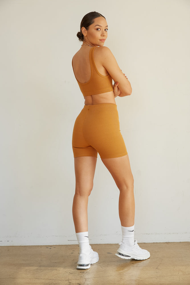 The back of this biker set has a scooped back and fitted shorts.
