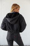 The back of this jacket has a sherpa lined hood.