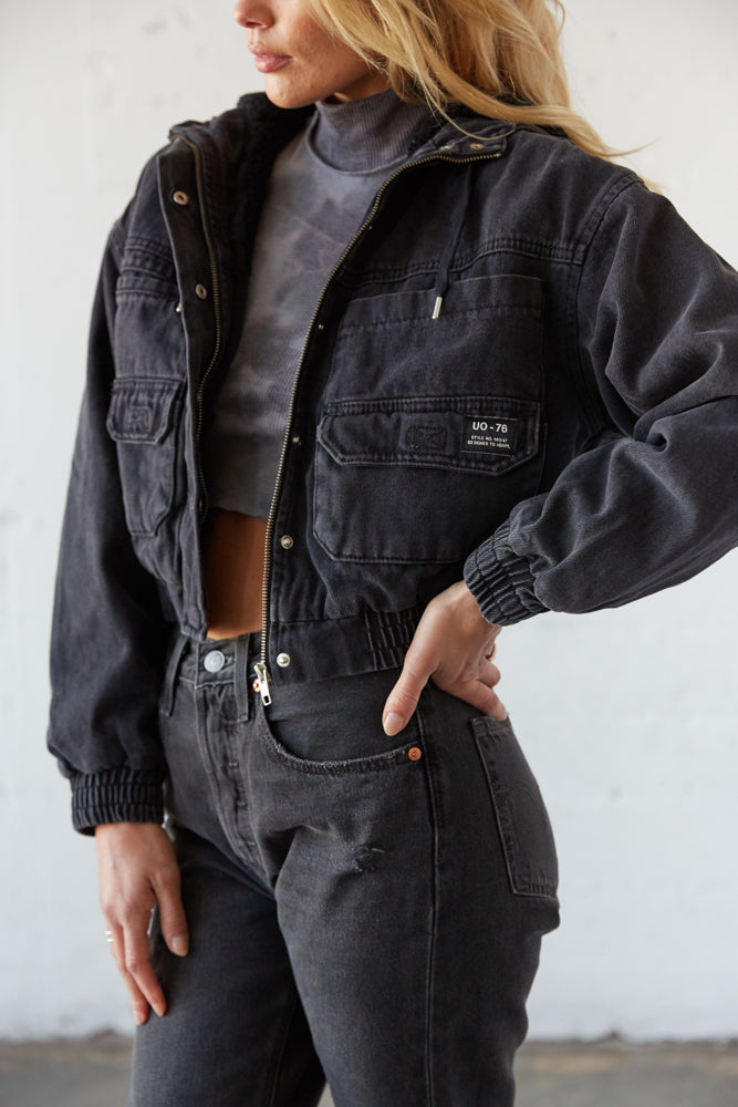The side of this jacket has pockets and a classic UO label.