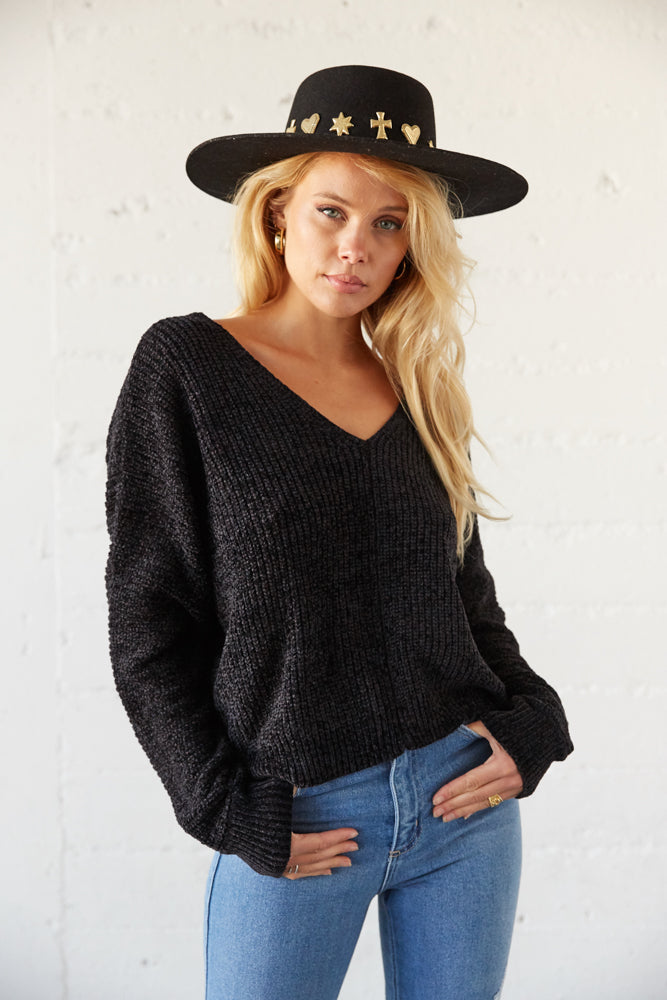 This V neck sweater features a soft chenille design.