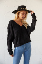 This cozy sweater has long slouchy sleeves.