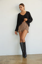 Cropped sweater with slouchy long sleeves.