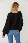 The back of this sweater is relaxed and cropped.