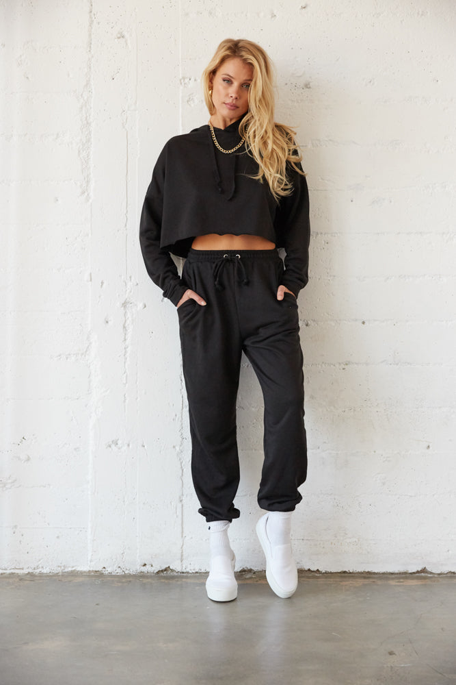 Black cropped sweatshirt with sweatpants.