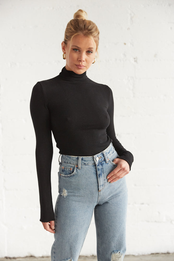 Black long sleeve shirt with soft ribbed design.