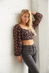 Crop floral print top with long puff sleeves and ruched bust.