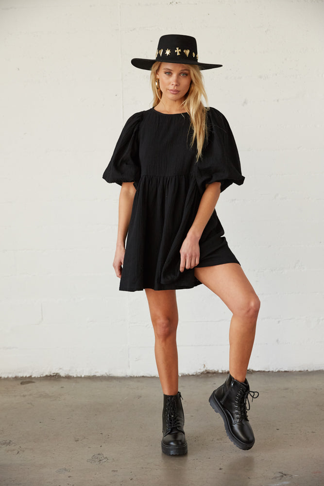 Black babydoll dress with combat boots.