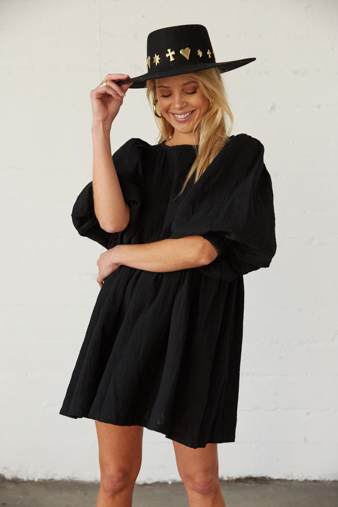 This ruffle dress has exaggerated puff sleeves.