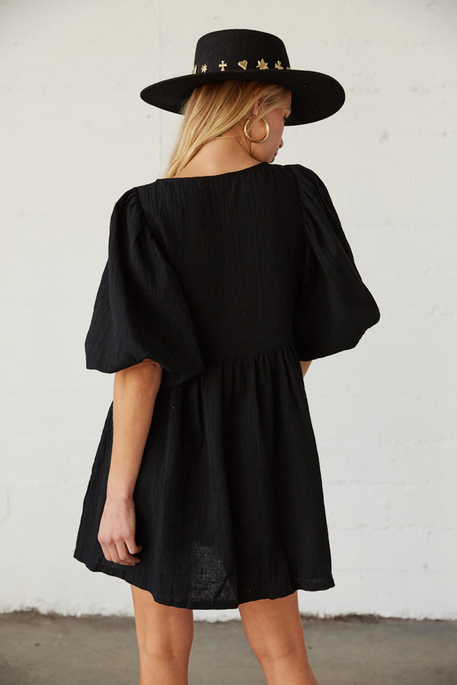 The back of this dress has a ruffled skirt.