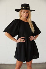 Black babydoll dress with puff sleeves.