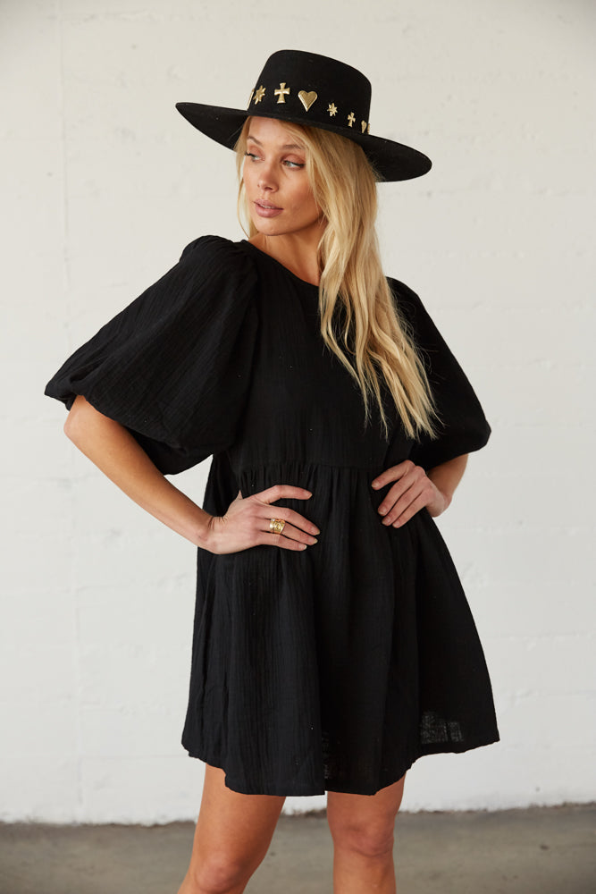 Black mini dress with puff sleeves.