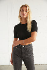 Black crop top with short sleeves and ruched body.