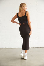 The back of this ribbed midi skirt is fitted for a flattering fit.