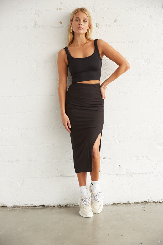 Black ribbed midi skirt with side slit detail.