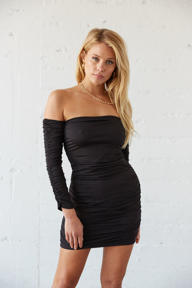 Black ruched mini dress with straight across neckline.