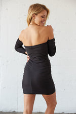 The back of this dress has a ruched design for a flattering fit.