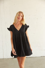 Black ruffle babydoll dress with short ruffle sleeves.