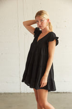 This dress has a tiered ruffle silhouette.
