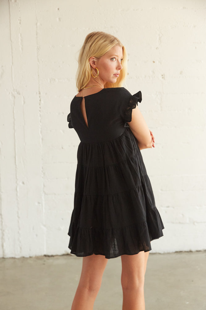 The back of this dress has a keyhole cutout with a button closure.