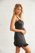 The side of this dress is relaxed with a ruffle trim.