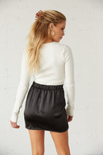 The back of this mini skirt has an elastic waistband.