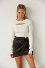 Black satin wrap mini skirt.