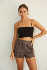 Pleated plaid high rise shorts.
