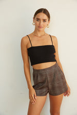 plaid high waisted shorts.