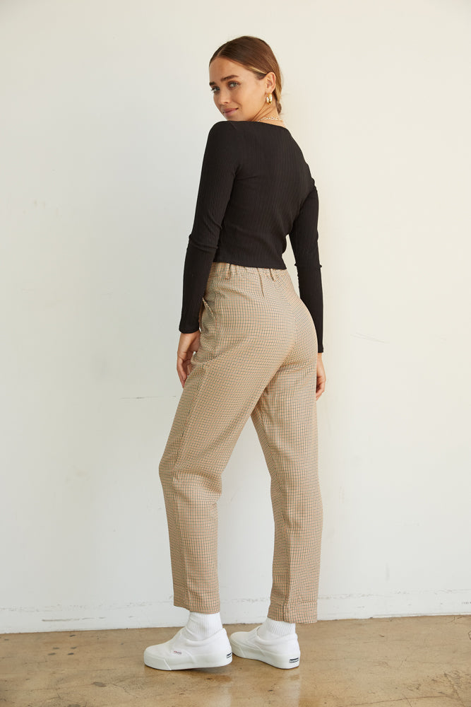 The back of these pants have an elastic waistband and a relaxed silhouette.