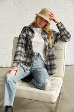 Black and white flannel shirt with white crop top.