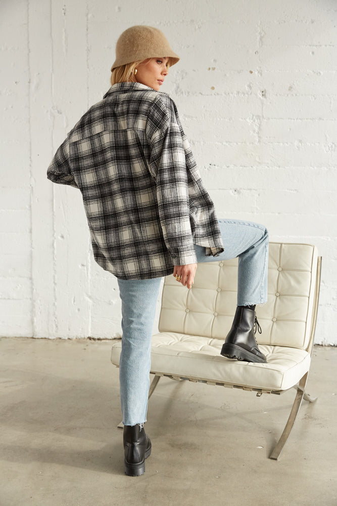 Oversized flannel shirt with jeans.